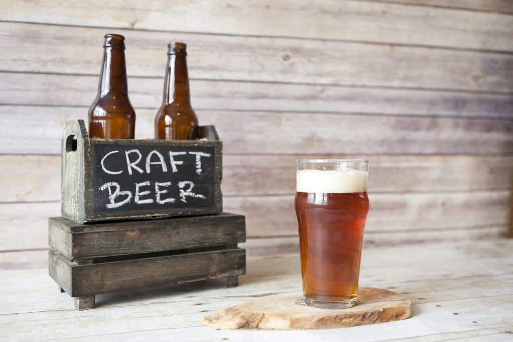 craft beer in a crate and pint